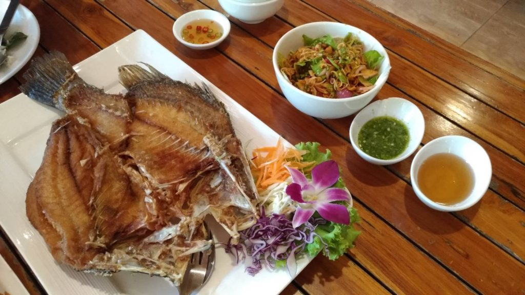 Thai deep fried fish with mango salad dipping